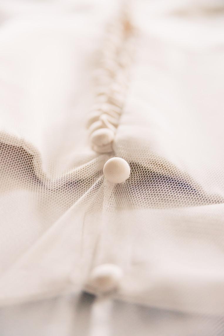 modern wedding dress button detail